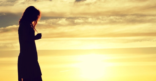 13435-woman-walking-sunset-silhouette-wide-1200w-tn